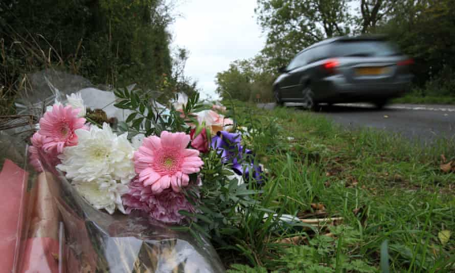 Floral tributes on the roadside near RAF Croughton in Northamptonshire, at the spot where Harry Dunn was killed.