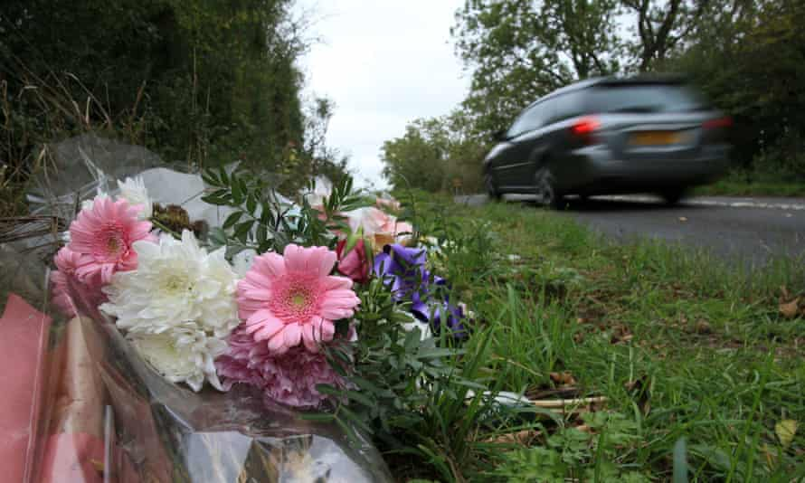 Floral tributes lay on the roadside near RAF Croughton in Northamptonshire, October 2019.