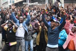 Kenyan fans celebrate in Nairobi, watching the record-breaking moment on a big screen.