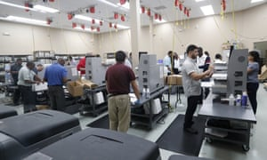 Employees at the Broward county supervisor of elections office count ballots during a recount on Wednesday.