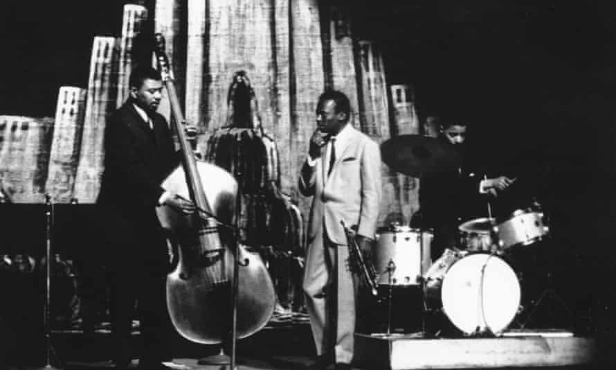 From left, bass player Paul Chambers, trumpeter Miles Davis and Jimmy Cobb at the Apollo theatre, New York, 1960.