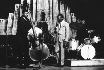 Miles Davis on stage with Cobb and the bass player Paul Chambers at the Apollo Theater in 1960.