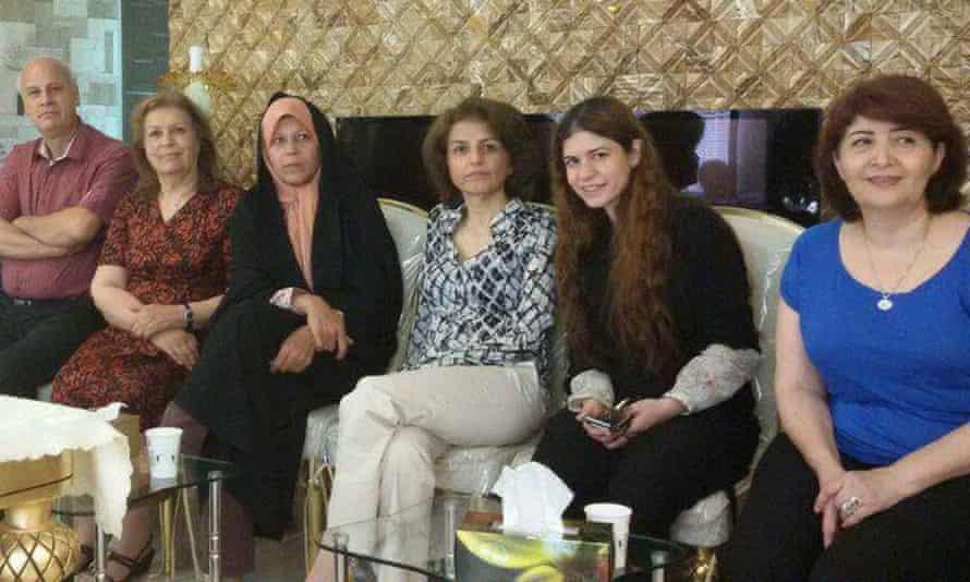 Faezeh Hashemi, centre-left, sitting next to Fariba Kamalabadi, centre-right