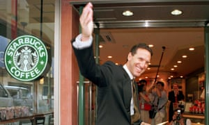 Schultz at the opening of a Starbucks location in Tokyo on 2 August 1996.