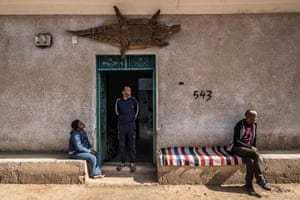 A mummified crocodile hangs above the door of the house of Mamdouh Hassan, centre, in the Nubian village of Gharb Soheil, on the banks of the Nile