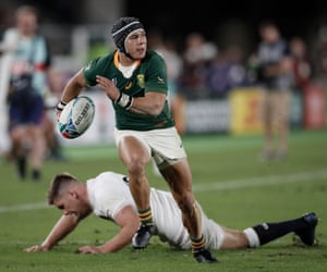 Cheslin Kolbe beats the tackle of Owen Farrell to run clear and score South Africa's second try late in the final.