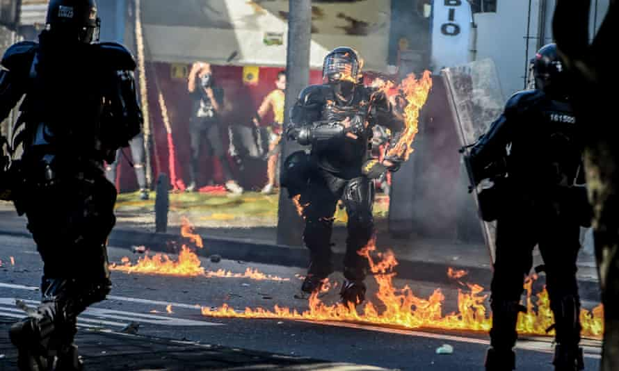 A riot police officer is hit by a petrol bomb during clashes with demonstrators protesting against police brutality in Medellín, Colombia, on Thursday.