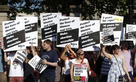 Pro-choice supporters hold placards at a protest