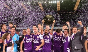 Perth Glory players and staff celebrate becoming the 2018/19 A-League premiers