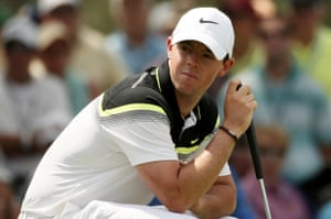 McIlroy bends down to line up his putt on the 7th