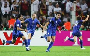 Fabio Grosso celebrates his extra time goal with Gianluca Zambrotta (left) and Alessandro Del Piero (second left).