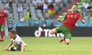 Portugal's Diogo Jota is fouled by Germany's Matthias Ginter.