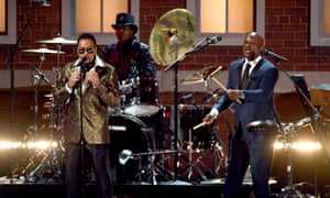 Morris Day, Jellybean Johnson, and Jerome Benton of music group The Time perform onstage