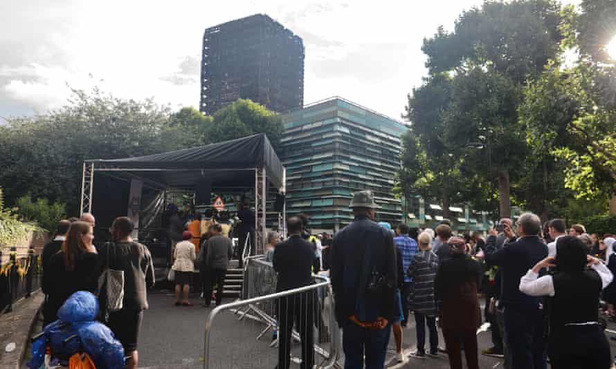 People attend a vigil near Grenfell Tower