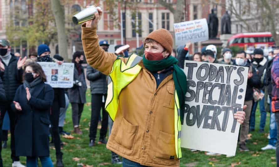 Hospitality workers call for additional support from the government at a protest in Parliament Square in December.