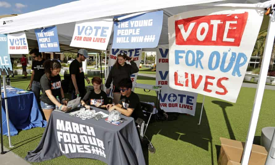 Student volunteers help out at a booth during a 'Vote for our lives' event at the University of Central Florida in Orlando, Florida.