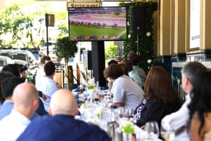 People watch the Melbourne Cup on TV from the Harbour View Hotel, at The Rocks in Sydney.