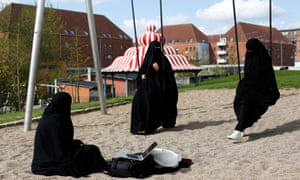 three burqa-clad Women in Superkilen, a recently designed urban renewal park beside Mjolnerparken.