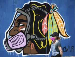 The Chicago Blackhawk logo is depicted wearing a respirator during the Covid-19 pandemic