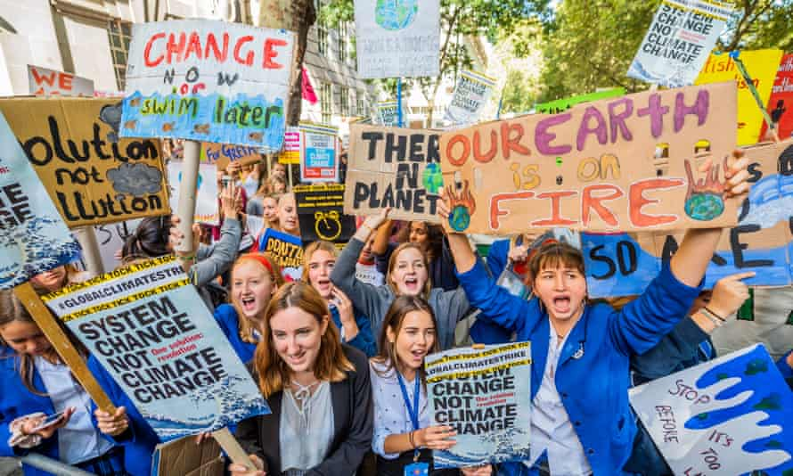 School pupils in central London holding placards as they take part in the Global Strike for Climate Justice, organised by Extinction Rebellion, Greenpeace and other groups in September 2019.