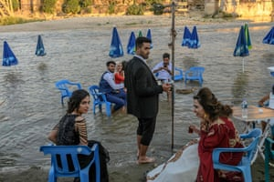 Newly married young man Mehmet and his wife Sultan enjoy next to the Tigris river
