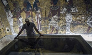 Egyptian archaeologist looks at sarcophagus of King Tutankhamun in his burial chamber in the Valley of the Kings, close to Luxor, 500km south of Cairo