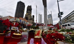 Candles, flowers and individual messages are placed at a makeshift memorial for the victims of the Christmas market attack.