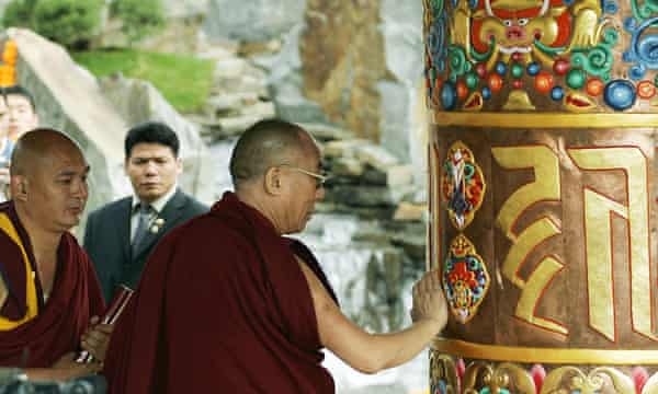 The Dalai Lama and his emissary Tendzin Dhonden (far left) during a blessing ceremony.