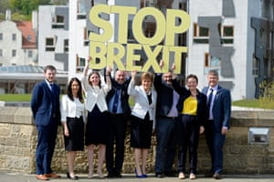 SNP candidates hold up a sign saying 'Stop Brexit'