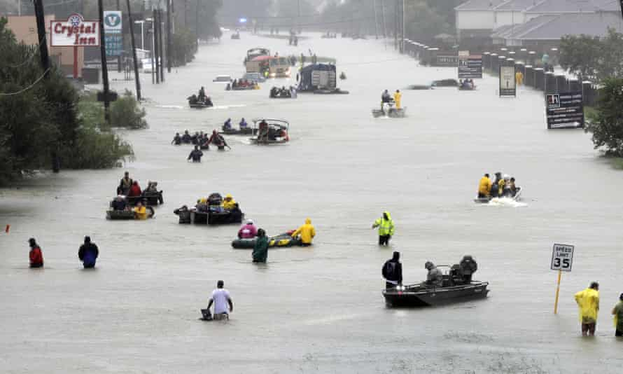Rescue boats float on a flooded street as people are evacuated from rising floodwaters brought on by Harvey in Houston, in August.