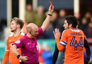 Luton Town's Alan Sheehan is shown a red card by Referee Nicholas Kinsley.