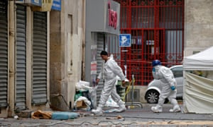 Forensics of the French police at work outside a building in Saint-Denis, near Paris the day after a police raid to catch fugitives from Friday night's deadly attacks
