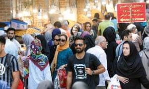 Iranians shop at Tehran's old bazaar on Monday.