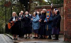 Nuns applaud outside St Anthony's convent of Mercy Tunstall in Sunderland.