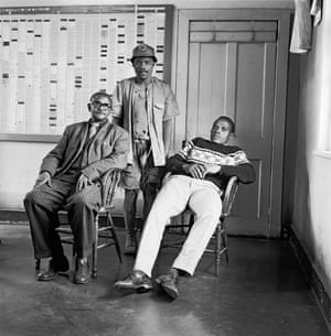 Time office clerks and a miner, City Deep Gold Mine, Johannesburg, 1966. From the series On the Mines (detail), 1966