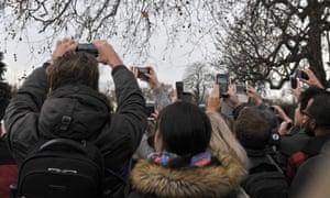 Tourists film Prince Harry and Meghan Markle at Kensington Palace