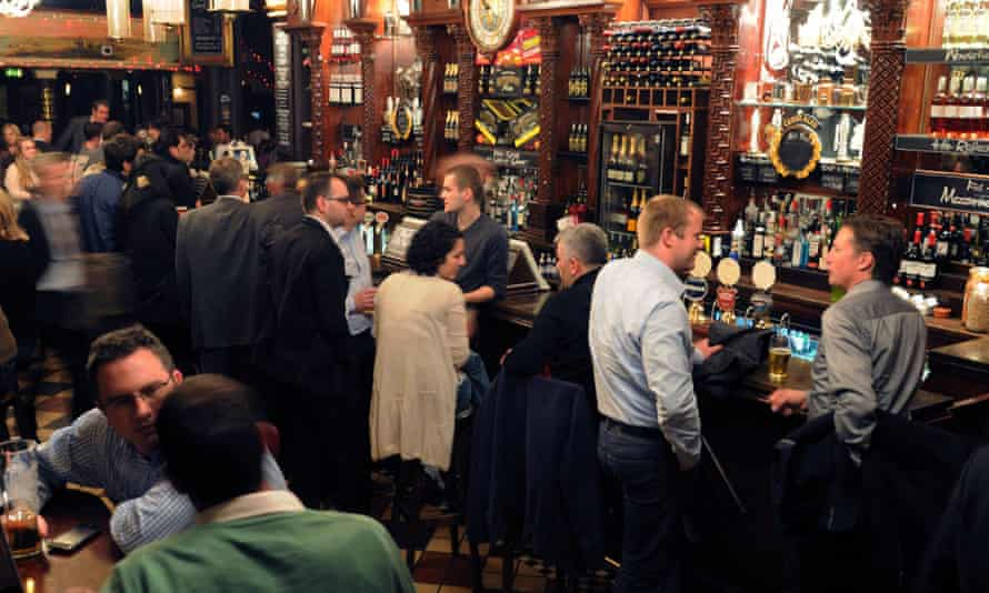 Interior of a busy pub in the City of London