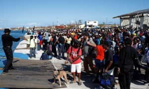 People wait for a ferry at Marsh Harbour port during an evacuation operation after Hurricane Dorian hit the Abaco Islands in Marsh Harbour, Bahamas.