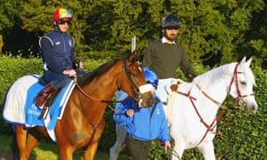 Sheikh Mohammed, right, escorts Frankie Dettori and the Godolphin trained horse Punctilious to the gallops at Newmarket in 2004.