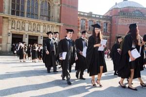 Graduates leaving their graduation ceremony