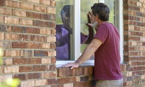 Jack Campise talks with his mother Beverly Kearns through a window at a nursing home in Windsor, Connecticut.