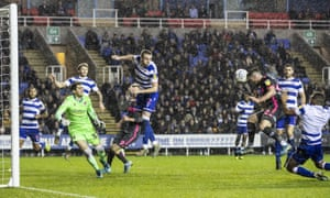 Jack Harrison heads in from Helder Costa's deflected cross to take Leeds top of the Championship at Reading.