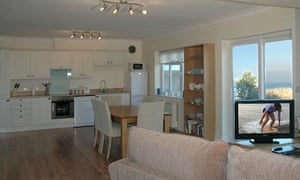 The dining and living area of the Safe Haven Cottage, Aberporth, Wales