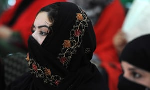 Jalalabad, Afghanistan An Afghan woman listens to a speech by first lady Rola Ghani during an event to mark World Women's Day