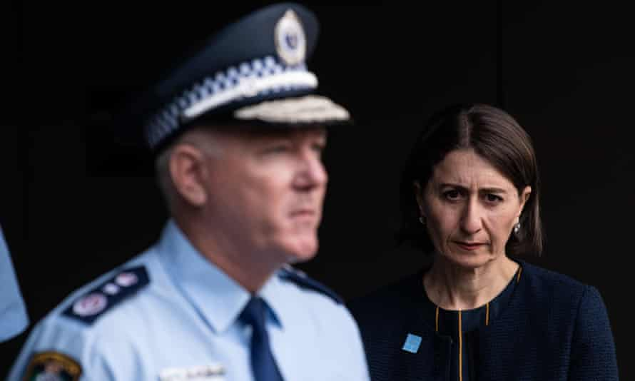 NSW Police Commissioner Mick Fuller speaks to the media while NSW Premier Gladys Berejiklian watches