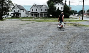Small Central Pennsylvania Town Plagued By Poverty And Opioid Addiction<br>WILLIAMSPORT, PA - JULY 13: A man walks away from a food pantry operated by the American Rescue Workers in the struggling city of Williamsport, which has recently seen an epidemic of opioid use among its population on July 13, 2017 in Williamsport, Pennsylvania. The American Rescue Workers, which was founded in 1884, is a church/nonprofit national religious organization that runs a shelter, food pantry and operates businesses for the unemployed and homeless. With a population just over 29,000, Williamsport has a poverty rate of over 27%. As cities across the nation continue to cope with an epidemic of opioid use, often in areas with few employment prospects, Williamsport recently experienced 36 heroin overdoses in a 24 hour period. (Photo by Spencer Platt/Getty Images)