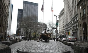 A almost deserted statue of the Charging Bull is seen near the New York Stock Exchange today.