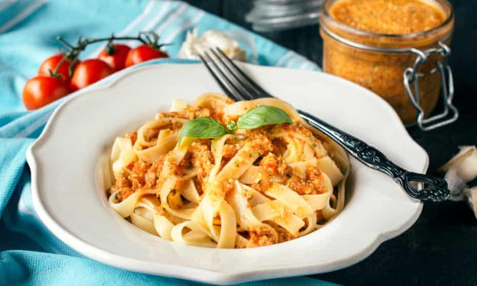 Fettuccine pasta with red Sicilian pesto.