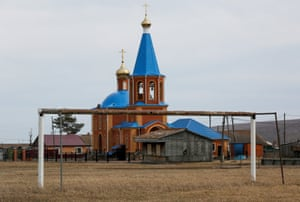A goalpost stands in front of an Orthodox church in the Siberian village of Tyulkovo in Krasnoyarsk region