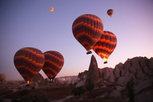Nevsehir, Turkey: Hot air balloons glide over Goreme district during early morning at the historical Cappadocia region, located in Central Anatolia